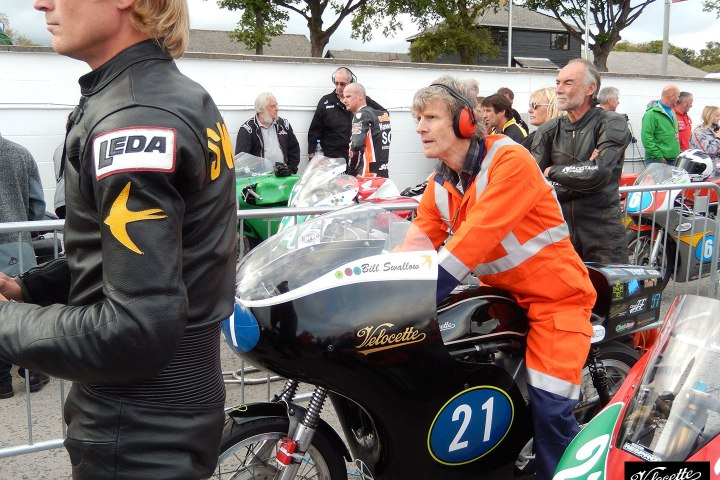 21 August, 2014. Chris Swallow, Nick Thompson, Bill Swallow and the Eldee TT 250cc Velocette Special on hold in Pit Lane, Isle of Man.